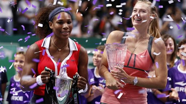 Winner Serena Williams of the U.S. (L) and second-placed Maria Sharapova of Russia pose after their final WTA tennis championships match in Istanbul,
