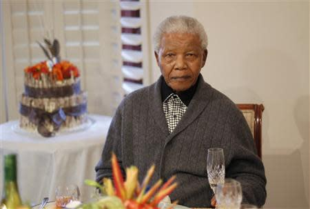 File photo of former South African President Nelson Mandela looking on as he celebrates his birthday at his house in Qunu