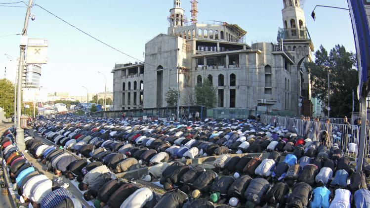 Thousand of Russian Muslims perform Eid al-Fitr prayers that mark the end of the holy fasting month of Ramadan outside the main Mosque in Moscow, Russia, Sunday, Aug. 19, 2012. (AP Photo/Mikhail Metzel)