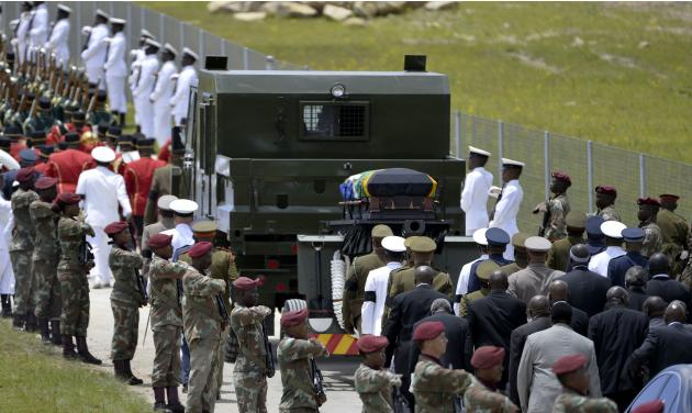 The coffin of former South African president Nelson Mandela is carried on a gun carriage for a traditional burial after the funeral ceremony in Qunu