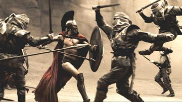 Leonidas ( Gerard Butler ) fights his way through the first wave of Persian infantry in Warner Bros. Pictures' 300