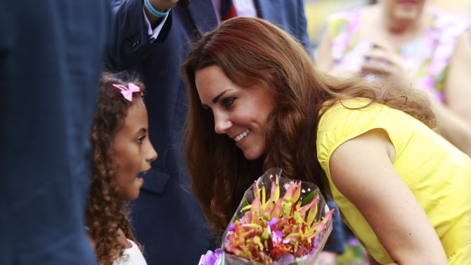 Britain's Kate, the Duchess of Cambridge, talks to a girl during the opening ceremony of the renovated Commonwealth Street in central Honiara, Solomon Islands, Monday, Sept. 17, 2012. Prince William, the Duke of Cambridge, and his wife Kate are on their third stop of a nine-day tour of Southeast Asia and the South Pacific on behalf of Queen Elizabeth II to commemorate her Diamond Jubilee. (AP Photo/Daniel Munoz, Pool)