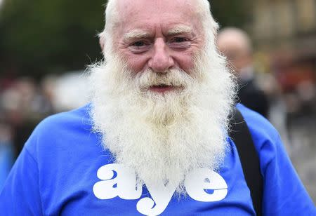A 'Yes' campaigner stands outside a campaign rally in Glasgow