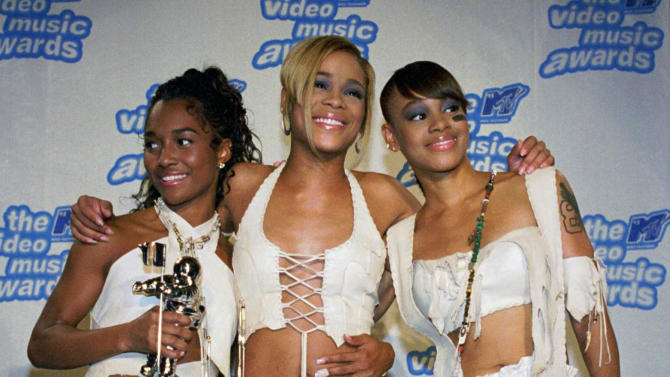 """FILE - In this Sept. 7, 1995 file photo, the band TLC, from left, Rozanda """"Chilli"""" Thomas, Tionne """"T-Boz"""" Watkins and Lisa """"Left Eye"""" Lopes, pose for photographers backstage at New York's Radio City Music Hall during the 12th Annual MTV Video Music Awards. TLC won in the Best R&B Video, Viewer's Choice and Best Video of the Year  categories for """"Waterfalls."""" For R&B singer Tionne """"T-Boz"""" Watkins, it has been a rocky road since the 2002 death of Lisa """"Left Eye"""" Lopez. Now, she puts her life on display through her new reality show, """"Totally T-Boz,"""" an hour-long, four-episode series that airs on cable network TLC on Tuesdays, beginning Jan. 1, 2013. (AP Photo/Paul Hurschmann, File)"""