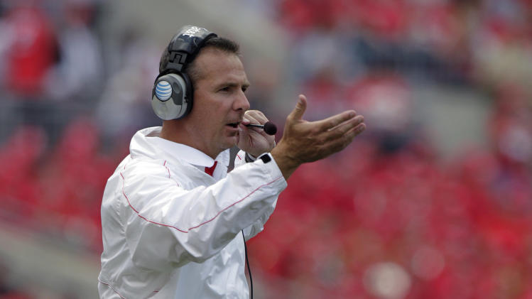 Ohio State's Urban Meyer coaches against UAB during the fourth quarter of an NCAA college football game Saturday, Sept. 22, 2012, in Columbus, Ohio. (AP Photo/Jay LaPrete)