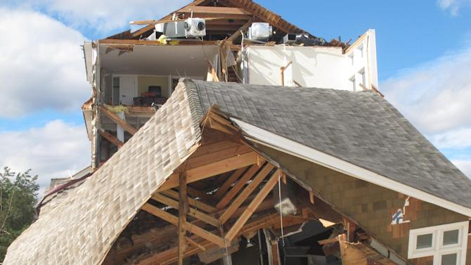 This Oct. 31, 2012 photo shows one of scores of homes in Mantoloking, N.J. that were destroyed by Superstorm Sandy. Even with federal reimbursement for much of the cleanup and rebuilding expenses, hard-hit towns could be facing property tax hikes next year as a result of the unexpected costs, and the loss of millions of dollars of taxable property. (AP Photo/Wayne Parry)