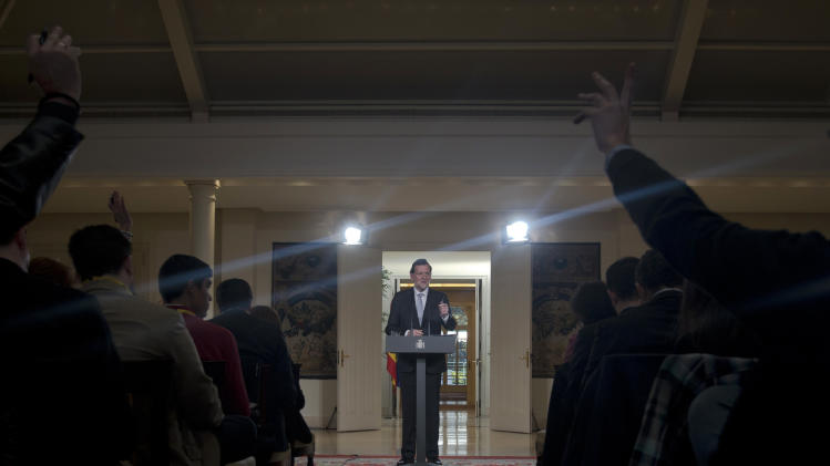Spain's Prime Minister Mariano Rajoy answers questions after a speech at the Moncloa Palace in Madrid, Friday Dec. 28, 2012. In his end of year assessment, Mariano Rajoy said Friday the crisis had been worse than he had anticipated and that the first half of 2013 will be very hard, but that the economy should begin to recover in the second semester. Rajoy says the country's economy will be in recession for some time and faces a tough year ahead as it grapples with a deep financial crisis and 25 percent unemployment. (AP Photo/Paul White)