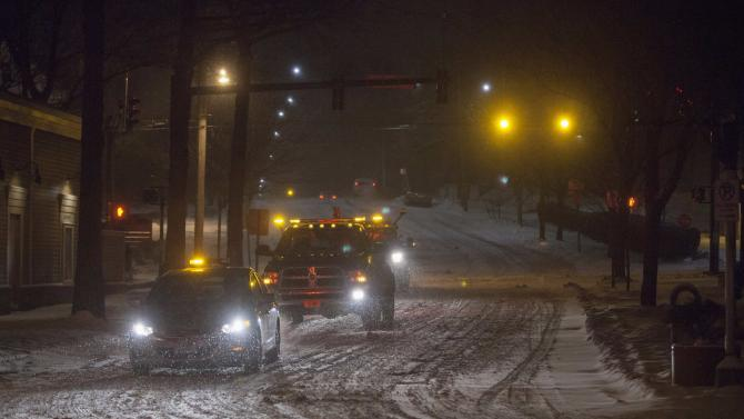 Tow trucks prepare to remove illegally parked vehicles after a parking and travel ban was put in place in New Haven