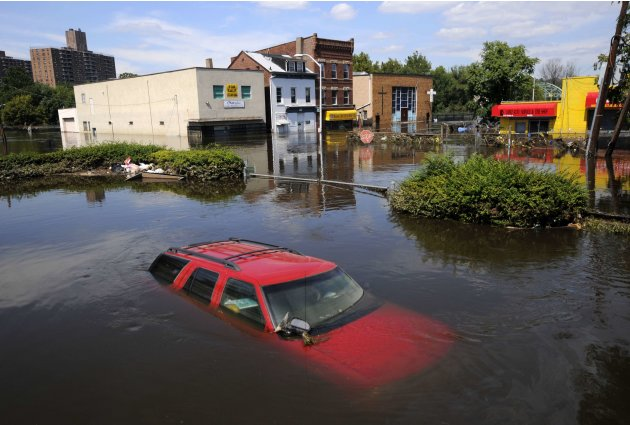 Flood waters from the Passaic River fill the streets covering automobiles including a Chevrolet SUV days after Hurricane Irene in Paterson, New Jersey