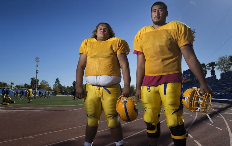 Sacramento (Calif.) Grant High offensive linemen Shawn Matautia (left) and Darrin Paulo weigh a combined 720 pounds -- Sacramento Bee