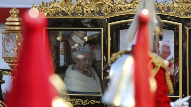 Britain's Queen Elizabeth arrives by carriage for the State Opening of Parliament at the Palace of Westminster