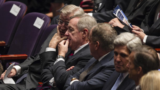 CORRECTS ID OF MAN AT SECOND LEFT TO SEN. DICK DURBIN INSTEAD OF SEN. TIM JOHNSON - Former U.S. Vice President Walter Mondale, left, Sen. Dick Durbin, D-Ill., second left, Sen. John Kerry, D-Mass, second right, and Sen. John Thune, D-S.D., right, chat before a funeral service for former Democratic U.S. Senator and three-time presidential candidate George McGovern at the Washington Pavilion of Arts and Science in Sioux Falls, S.D., Friday, Oct. 26, 2012. McGovern died Sunday in his native South Dakota at age 90. (AP Photo/Nati Harnik/pool)
