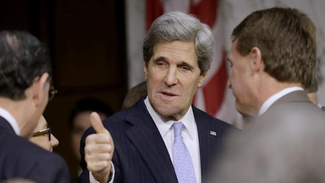 Senate Foreign Relations Chairman Sen. John Kerry, D-Mass., President Barack Obama's nominee to become secretary of state, gives a 'thumbs-up' as he arrives  on Capitol Hill in Washington, Thursday, Jan. 24, 2013, to testify before his confirmation hearing before the committee to replace Hillary Rodham Clinton.  (AP Photo/Pablo Martinez Monsivais)