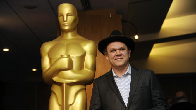 Host John C. Reilly poses at a reception featuring the Oscar nominees in the Animated Feature Film category on Friday, Feb. 28, 2014, at the Academy of Motion Picture Arts and Sciences in Beverly Hills, Calif. The 86th Oscars ceremony will be held on Sunday at the Dolby Theatre in Los Angeles. (Photo by Chris Pizzello/Invision/AP)