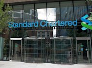 This file photo shows headquarters of Standard Chartered Bank in London, pictured in April. Emerging markets-focused lender was recently plunged into crisis when a US regulator accused the bank of hiding $250 bln in transactions with Iran. Standard Chartered denied the allegations but paid $340 mln to settle the dispute.