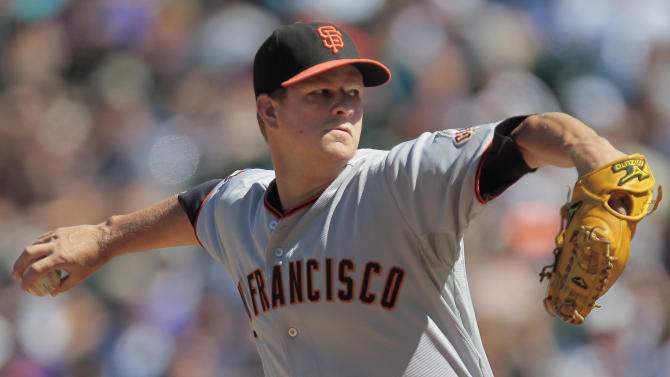 San Francisco Giants starting pitcher Matt Cain (18) takes on Colorado Rockies' Eric Young Jr. during the first inning of a baseball game Sunday, Sept. 18, 2011 in Denver. (AP Photo/Barry Gutierrez)
