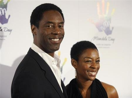 Actor Isaiah Washington (L) and wife Jenisa attend the &quot;Mandela Day&quot; awareness event in Beverly Hills, California May 14, 2009. REUTERS/Phil McCarten