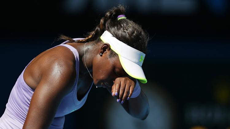 Sloane Stephens of the US reacts during her semifinal match against Victoria Azarenka of Belarus at the Australian Open tennis championship in Melbourne, Australia, Thursday, Jan. 24, 2013. (AP Photo/Aaron Favila)
