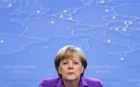 Germany's Chancellor Angela Merkel addresses a news conference during a European Union leaders summit in Brussels October 25, 2013. REUTERS/Francois Lenoir