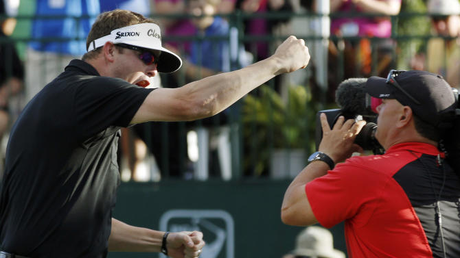 Charlie Beljan celebrates his win on the 18th green after making the winning putt at the Children's Miracle Network Hospitals golf tournament in Lake Buena Vista, Fla., Sunday, Nov. 11, 2012. (AP Photo/Reinhold Matay)