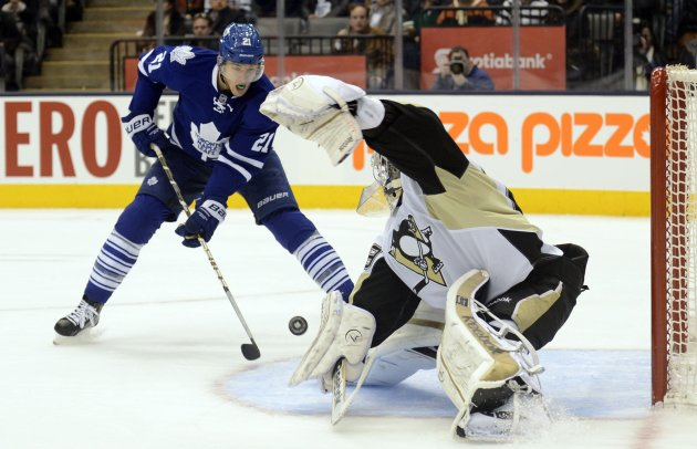 Penguins goalie Fleury makes a save against Maple Leafs van Riemsdyk during the second period of their NHL hockey game in Toronto