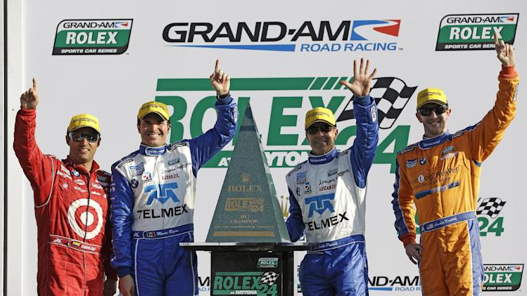 From left, Ganassi Racing team drivers Juan Pablo Montoya, of Colombia, Memo Rojas, of Mexico, Scott Pruett and Charlie Kimball celebrate after winning the Grand-Am Series Rolex 24 hour auto race at Daytona International Speedway, Sunday, Jan. 27, 2013, in Daytona Beach, Fla. (AP Photo/John Raoux)