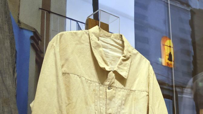 """In this Wednesday, Oct. 17, 2012 photo, a guayabera said to have been worn by the Spanish military in 1897 in Cuba, is on display at an exhibition titled """"The Guayabera: A Shirt's Story"""" at the Museum of History Miami, in Miami. This is the first exhibition to trace the story of the shirt's evolution through Cuba, Mexico, and the United States. (AP Photo/Lynne Sladky)"""