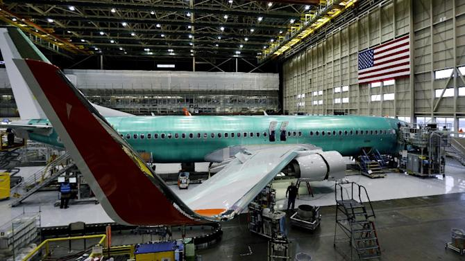 In this Tuesday, Jan. 29, 2013, photo, a Boeing Co. next-generation 737 airplane sits nearly completed at the end of Boeing's 737 assembly facility in Renton, Wash. Boeing is sticking with plans to speed up production of its 787 and sees no reason to change the lithium-ion battery design at the center of the troubled plane's problems, its CEO said Wednesday, Jan. 30. (AP Photo/Ted S. Warren)