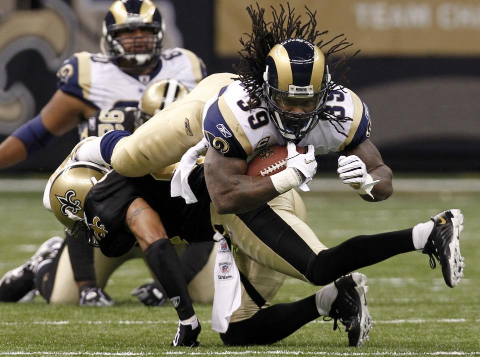 St. Louis Rams running back Steven Jackson (39) is upended by New Orleans Saints safety Darren Sharper (42) in the first half of an NFL football game at the Louisiana Superdome in New Orleans, Sunday, Dec. 12, 2010. The Saints won 31-13.  (AP Photo/Gerald Herbert)