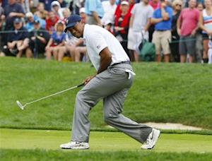 U.S. team member Tiger Woods misses a putt on the 14th green as he plays International member Richard Sterne of South Africa during the Singles matches for the 2013 Presidents Cup golf tournament at Muirfield Village Golf Club in Dublin