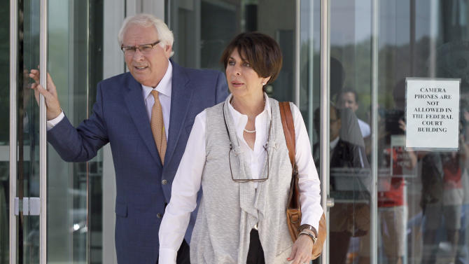 Former Arkansas Treasurer Martha Shoffner, right leaves the Little Rock, Ark., Federal Courthouse with her attorney Chuck Banks Thursday, June 27, 2013, after Shoffner pleaded not guilty to charges she steered state investments to a bond broker who paid her $36,000 in cash. (AP Photo/Danny Johnston)