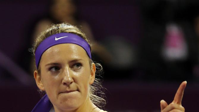 Belarus' Victoria Azarenka gestures,  after her victory against Serena Williams of the US, in the final match of the Qatar WTA Ladies Open tennis tournament, in Doha, Qatar, Sunday, Feb. 17, 2013. (AP Photo/Osama Faisal)