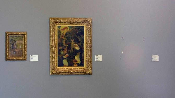 "FILE - This Tuesday Oct. 16, 2012 file photo shows the empty space where Henri Matisse' painting ""La Liseuse en Blanc et Jaune"" was hanging, right, is seen next to a painting by Maurice Denis, center, and Pierre Bonnard, left, at Kunsthal museum in Rotterdam, Netherlands A Romanian museum is analyzing ashes found in a stove to see if they are the remains of seven paintings by Picasso, Matisse, Monet and others that were stolen last year from the Netherlands, an official said Tuesday July 16, 2013. (AP Photo/Peter Dejong File)"