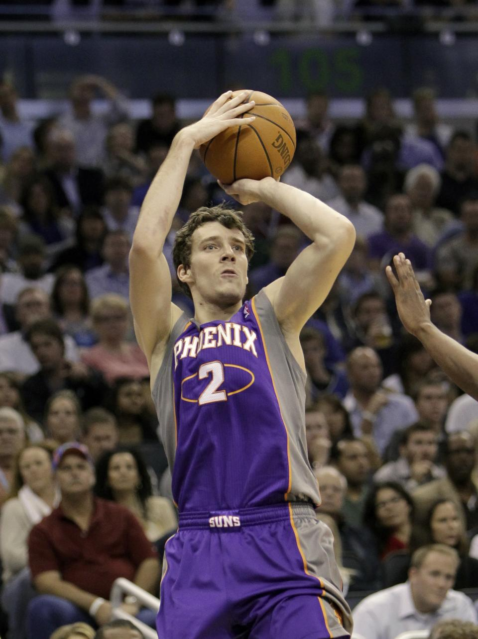 In a Nov. 18, 2010 photo Phoenix Suns' Goran Dragic, of Slovenia, takes a shot during an NBA game in Orlando, Fla.  Point guard Goran Dragic is coming back to Phoenix, according to a person with knowledge of the situation.  (AP Photo/John Raoux)