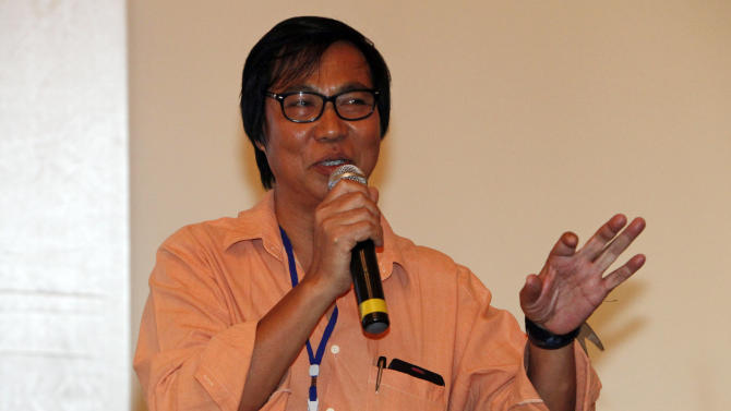 In this photo taken on Sunday, Feb. 3, 2013, Myanmar poet Saw Wai talks at the third day session of the Irrawaddy Literary Festival at Inya Lake hotel in Yangon, Myanmar. Nearly two years into reformist president Thein Sein's term, the rush of hope and idealism that greeted many new freedoms - most strikingly freedom of speech - is turning into a measured assessment of the country's progress. Long accustomed to writing around censorship, Myanmar's writers are relearning the habits of free thought and testing the boundaries of speech.  (AP Photo/Khin Maung Win)