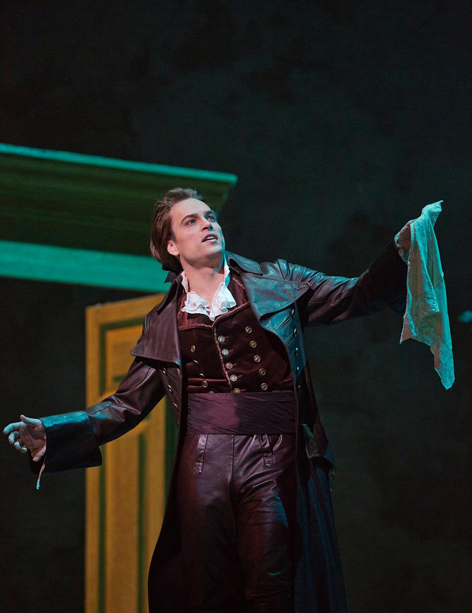 "In this Dec. 13, 2012 publicity photo, Alek Shrader as Count Almaviva is seen in Rossini's ""The Barber of Seville,"" during rehearsal at the Metropolitan Opera in New York. (AP Photo/Metropolitan Opera, Ken Howard)"
