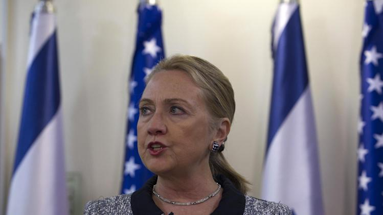 "U.S. Secretary of State Hillary Rodham Clinton and Israel's Prime Minister Benjamin Netanyahu (not seen) deliver joint statements in Jerusalem, Tuesday, Nov. 20, 2012. A diplomatic push to end Israel's nearly weeklong offensive in the Gaza Strip gained momentum Tuesday, with Egypt's president predicting that airstrikes would soon end, the U.S. secretary of state racing to the region and Israel's prime minister saying his country would be a ""willing partner"" to a cease-fire with the Islamic militant group Hamas.(AP Photo/Baz Ratner, Pool)"
