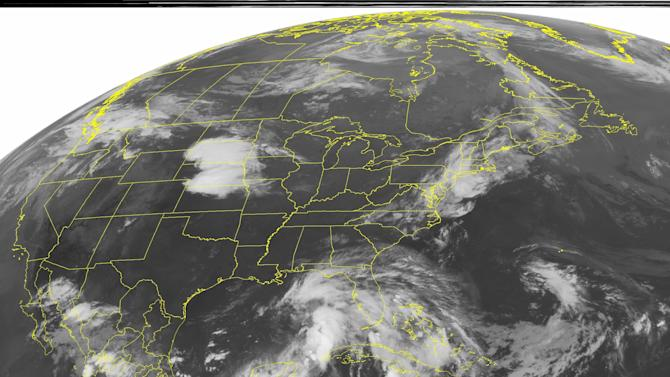 This NOAA satellite image taken Saturday, June 23, 2012 at 1:45 a.m. EDT shows clouds in the Gulf of Mexico associated with a tropical disturbance that has a good chance of strengthening through the weekend.  The eventual storm has the Gulf Coast on high alert the eventual track is far from certain.  Rain and thunderstorms are expected for Florida due to this disturbance.  An area of clouds in the Plains is associated with strong thunderstorms that produced at least one tornado Friday evening. (AP PHOTO/WEATHER UNDERGROUND)