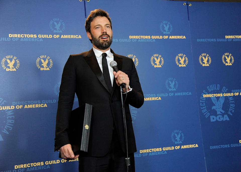 "Ben Affleck speaks holding his award for outstanding directorial achievement in feature film for ""Argo"" at the 65th Annual Directors Guild of America Awards at the Ray Dolby Ballroom on Saturday, Feb. 2, 2013, in Los Angeles. (Photo by Chris Pizzello/Invision/AP)"