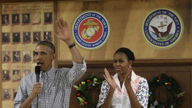 U.S. President Barack Obama and First Lady Michelle Obama greet U.S. military personnel at Marine Corps Base Hawaii on Christmas Day in Kaneohe Bay, Hawaii