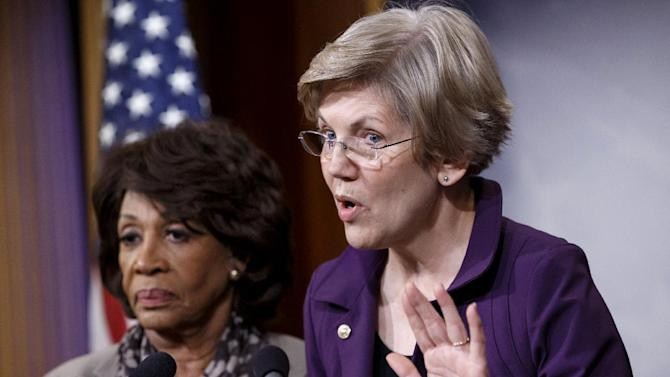 Sen. Elizabeth Warren, D-Mass., a member of the Senate Banking Committee, right, and Rep. Maxine Waters, D-Calif., ranking member of the House Financial Services Committee, express their outrage to reporters that a huge, $1.1 trillion spending bill approved by the Republican-controlled House yesterday contains changes to the 2010 Dodd-Frank law that regulates complex financial instruments known as derivatives, Wednesday, Dec. 10, 2014, on Capitol Hill in Washington. Democratic support for the omnibus bill funding every corner of government faded Wednesday as liberal lawmakers erupted over a provision that weakens the regulation of risky financial instruments and another that allows more money to flood into political parties. (AP Photo/J. Scott Applewhite)