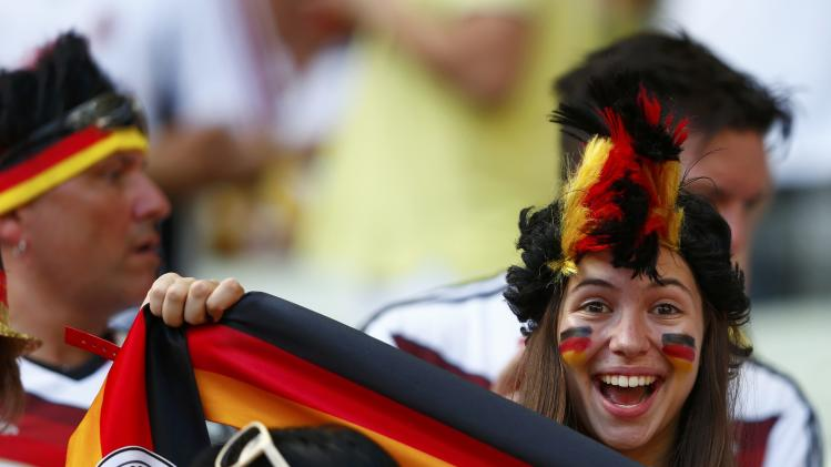 Germany fans cheer before the 2014 World Cup Group G soccer match between Germany and Ghana at the Castelao arena