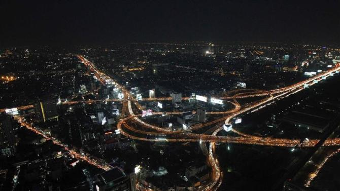 File photo of a view from a tall building showing traffic moving on highways in Bangkok