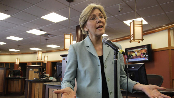 "In this May 2, 2012 photo, Democratic candidate for the U.S. Senate, Elizabeth Warren, speaks to reporters during a news conference while campaigning at Liberty Bay Credit Union headquarters in Braintree, Mass. Warren addressed questions on her claim of Native American heritage. Warren, a Harvard Law School professor who is running in Massachusetts against Republican incumbent Scott Brown, was listed as Native American in several law school directories. Warren has said that her ""family lore"" described Indian ancestors, and the New England Genealogy Association said it found indications that Warren had a Cherokee great-great-great grandmother, which would make her 1/32 Indian. (AP Photo/Steven Senne)"