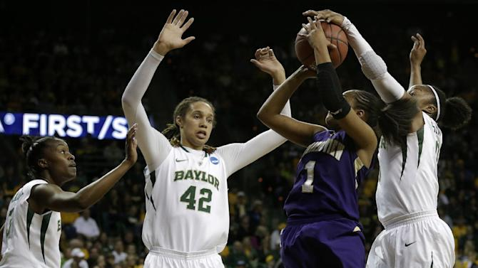 Baylor's Jordan Madden, left, and Brittney Griner (42) watch as Odyssey Sims (0), right, blocks a shot-attempt by Prairie View A&M guard Jeanette Jackson (1) in the first half of a first-round game in the women's NCAA college basketball tournament on Sunday March 24, 2013, in Waco, Texas. (AP Photo/Tony Gutierrez)