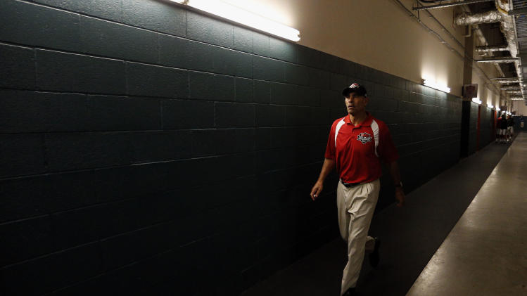 IMAGE DISTRIBUTED BY AP IMAGES FOR NFLPA- American team head coach Herm Edwards walks through the tunnel to the field before the NFLPA Collegiate Bowl on Saturday, Jan. 19, 2013 in Carson, Calif. (Ric Tapia/AP Images for NFLPA)