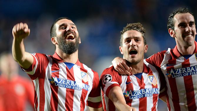Atletico Madrid's Arda Turan, left, Koke, center, and Diego Godin celebrate after the Champions League semifinal second leg soccer match between Chelsea and Atletico Madrid at Stamford Bridge Stadium in London, Wednesday, April 30, 2014