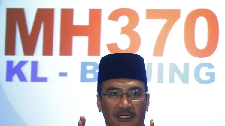 Malaysia's acting Transport Minister Hishammuddin Tun Hussein speaks during news conference about missing Malaysia Airlines flight MH370, at Kuala Lumpur International Airport