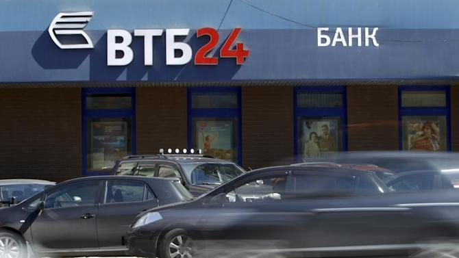Cars drive past an office of VTB bank in Moscow