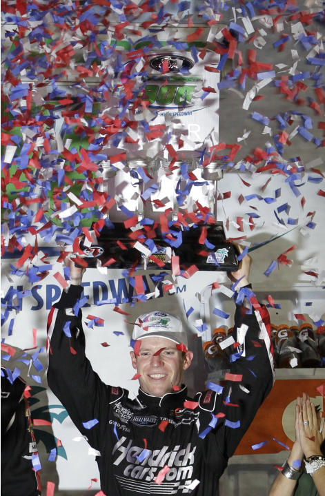 Driver Regan Smith holds up the trophy as he celebrates in victory lane after winning the NASCAR Nationwide Series auto race at Homestead-Miami Speedway Saturday, Nov. 17, 2012 in Homestead, Fla.  (AP